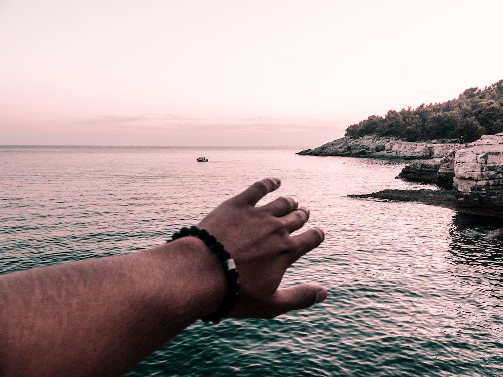 man wearing black beaded bracelet