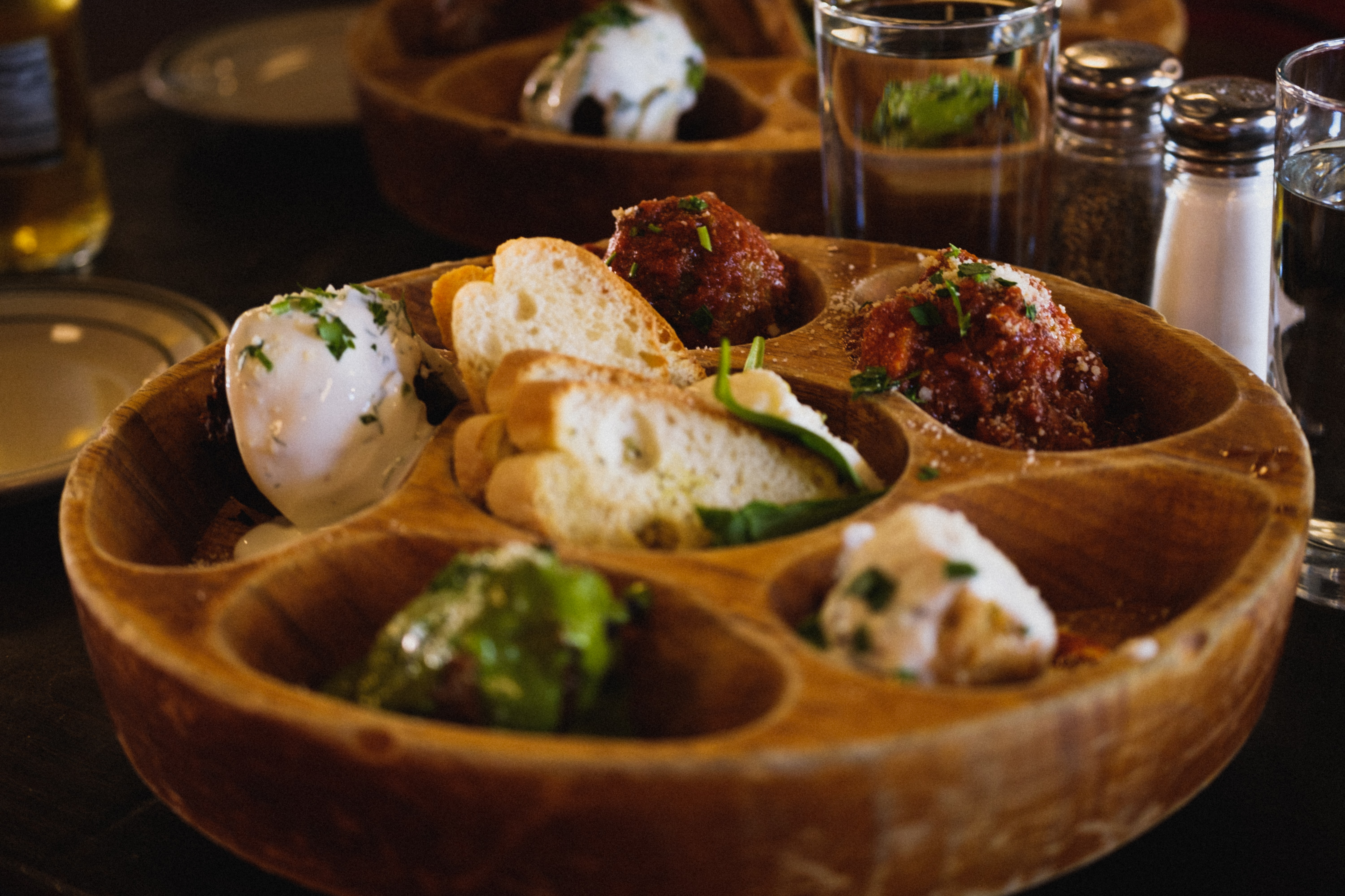 food photography of partition tray with bread and dips