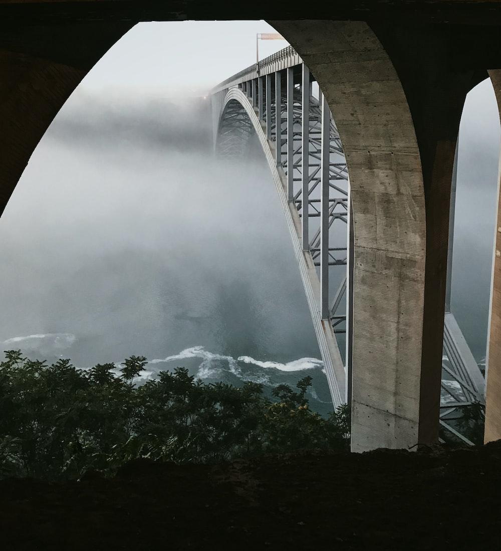 gray concrete arch bridge
