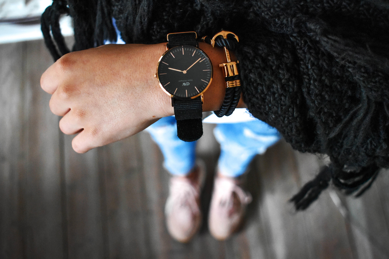 black analog watch displaying 3:38