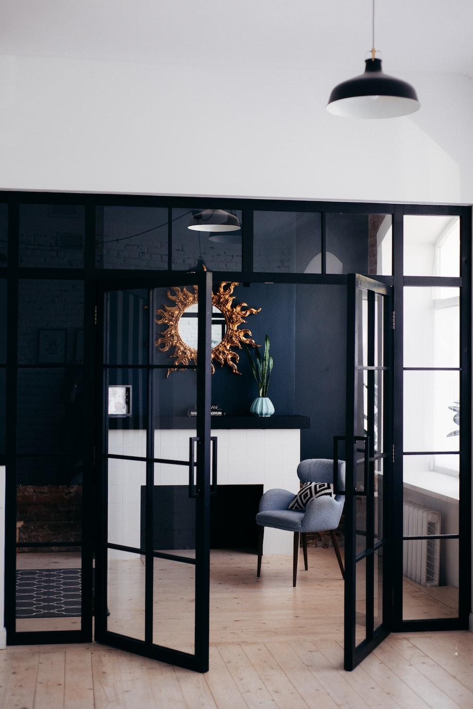 opened black wooden 8-panel door