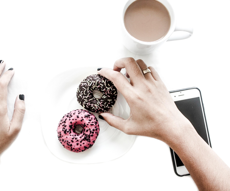 person holding doughnut