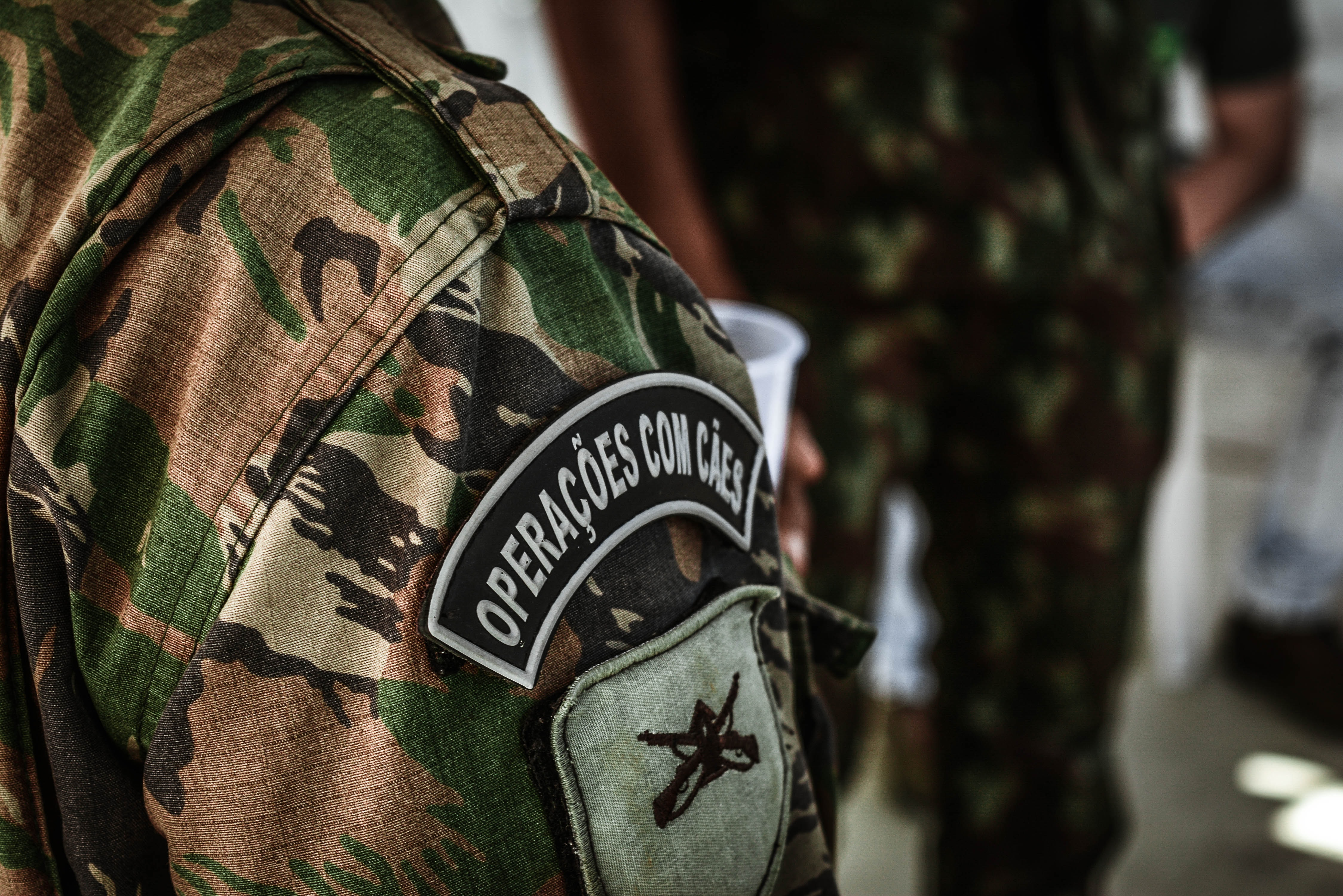 closeup photo of brown and green camouflage top
