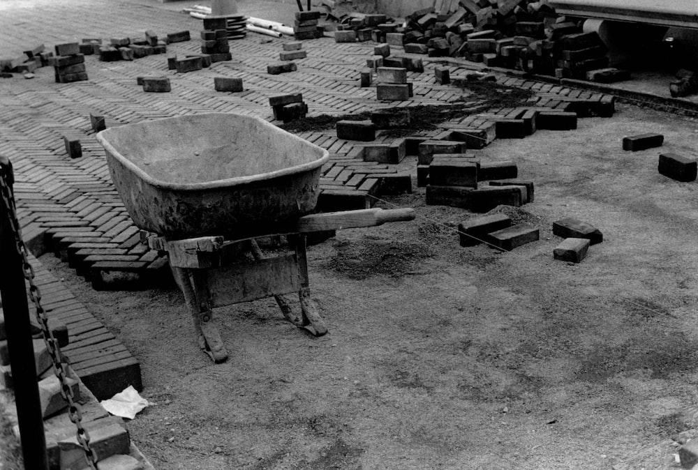 grayscale photo of wheelbarrow