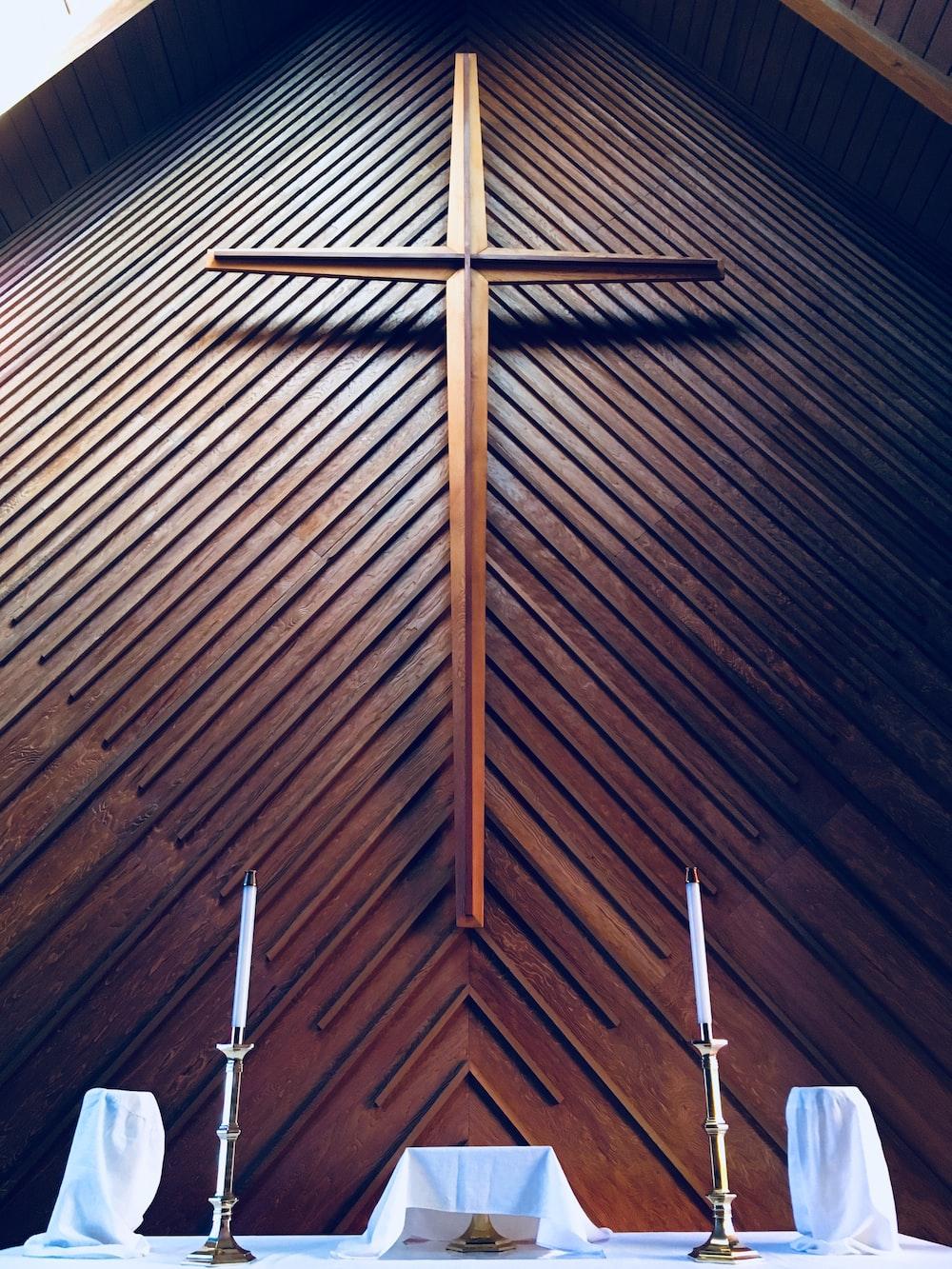 brown cross on altar