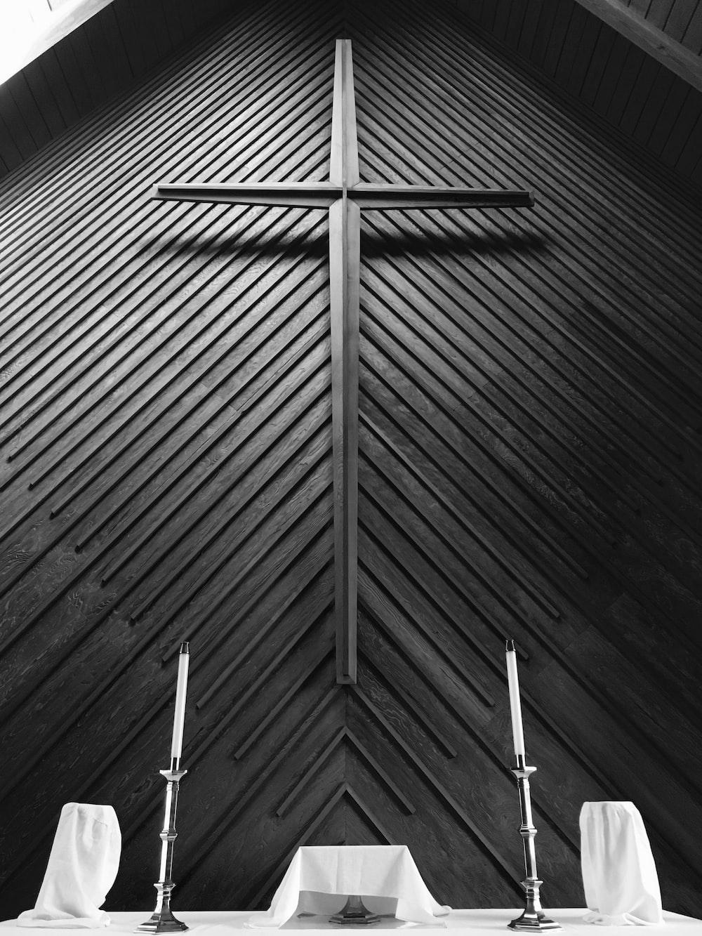 Church altar with black cross on wall