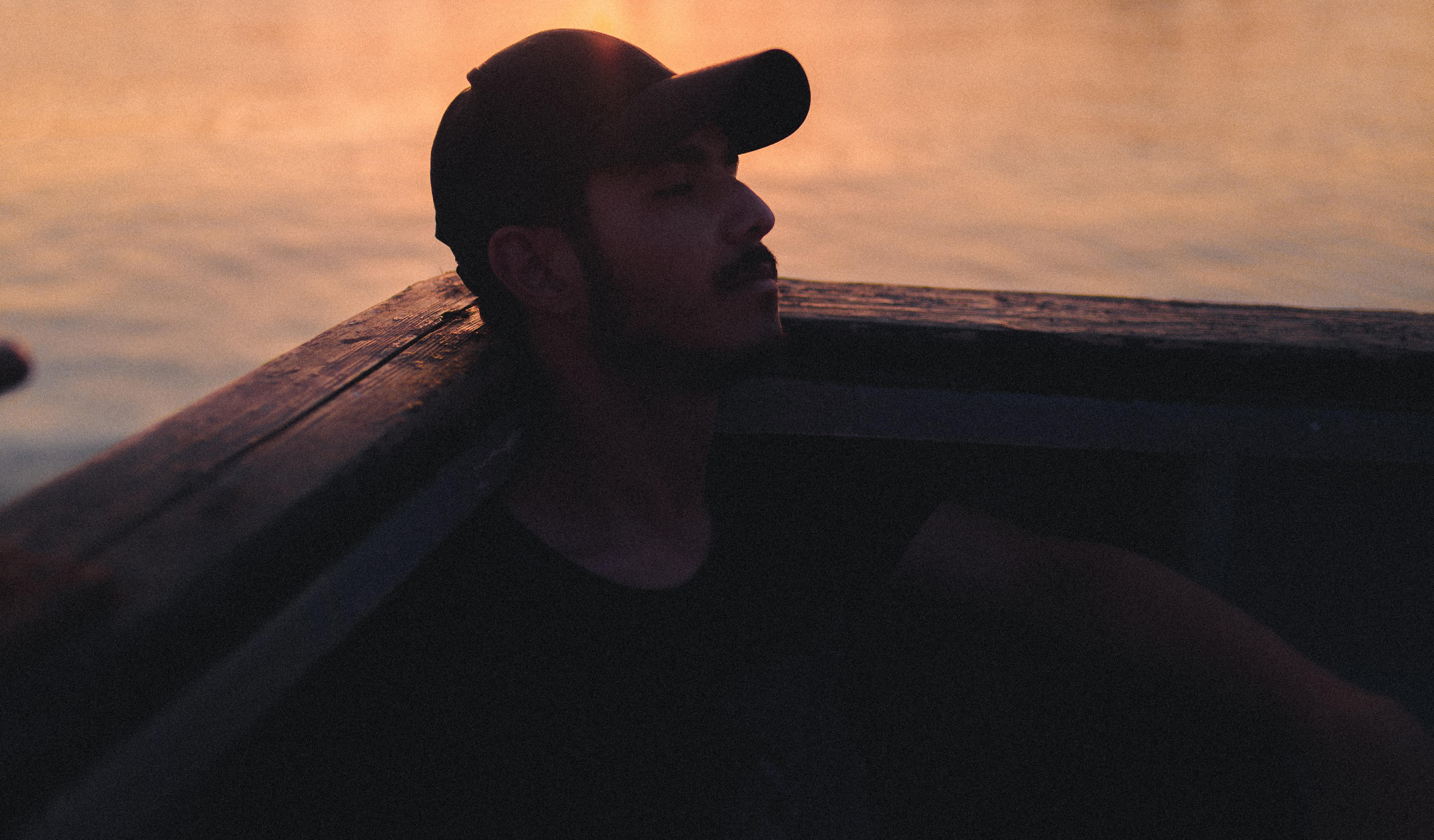 man wearing black cap and shirt