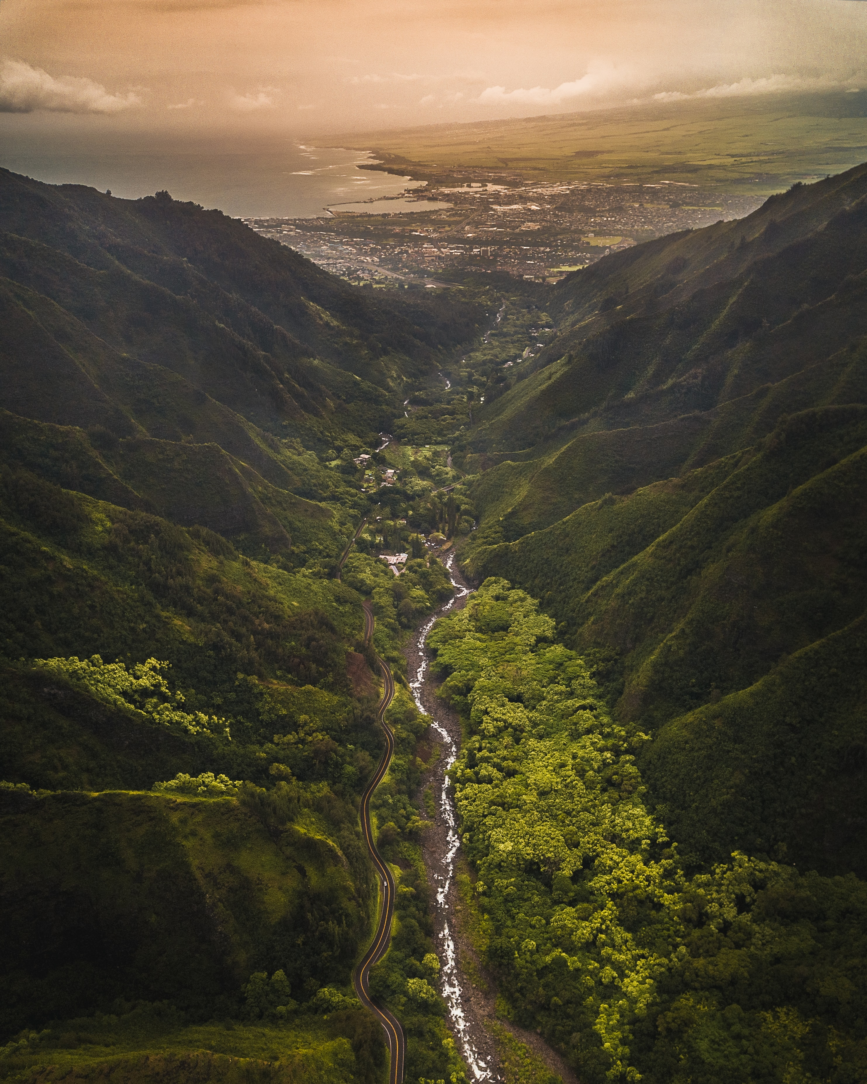 aerial photography of river between mountain