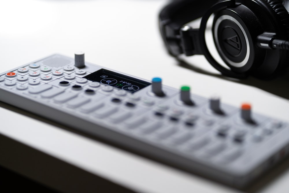 headphones beside music player