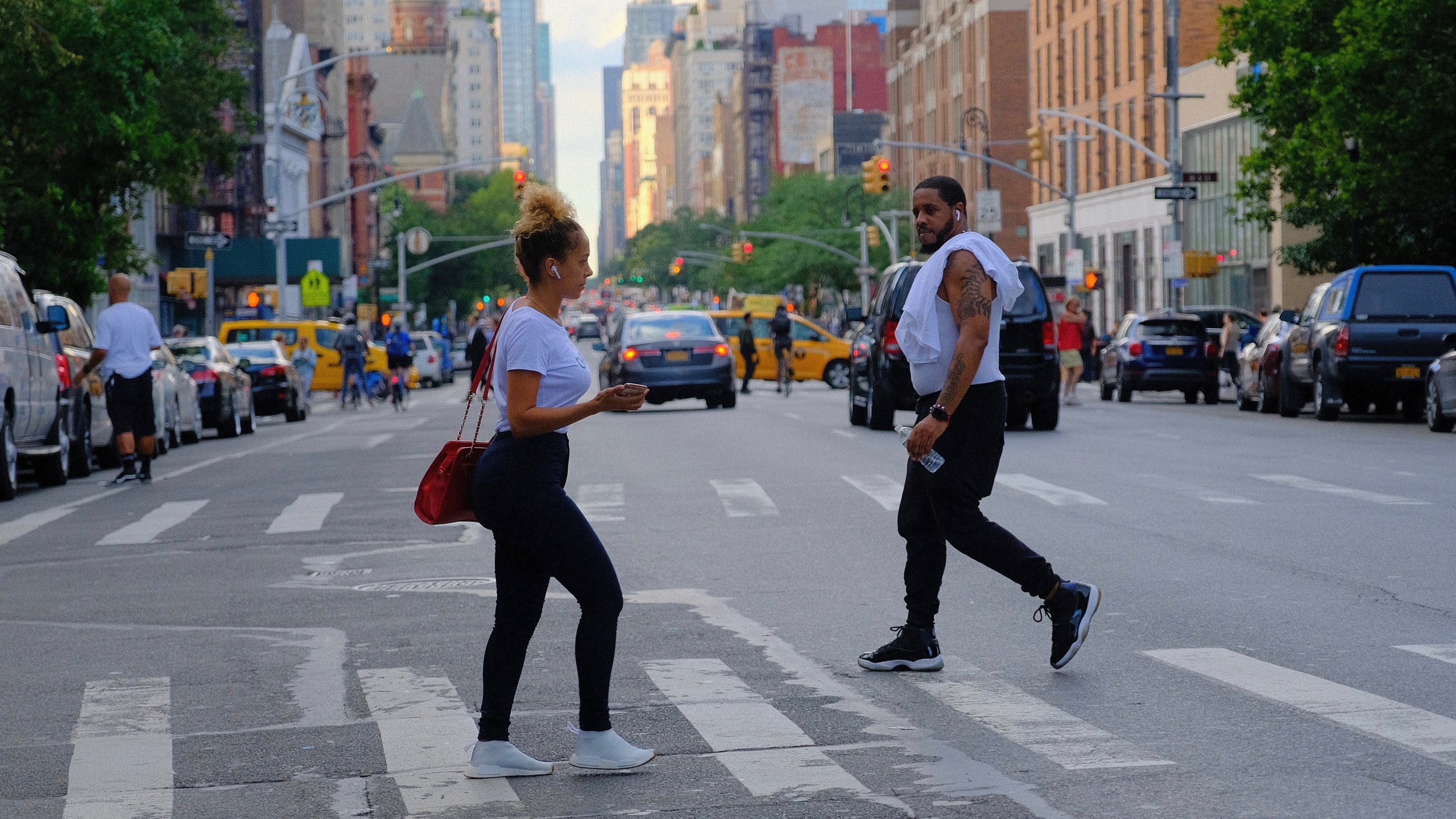 man and woman crossing on the street