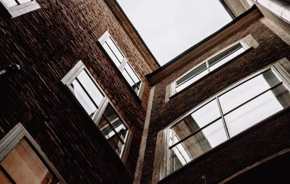 low angle photography of brown building