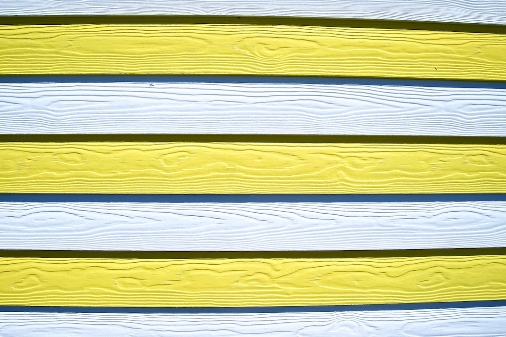 white, blue, and yellow wooden board