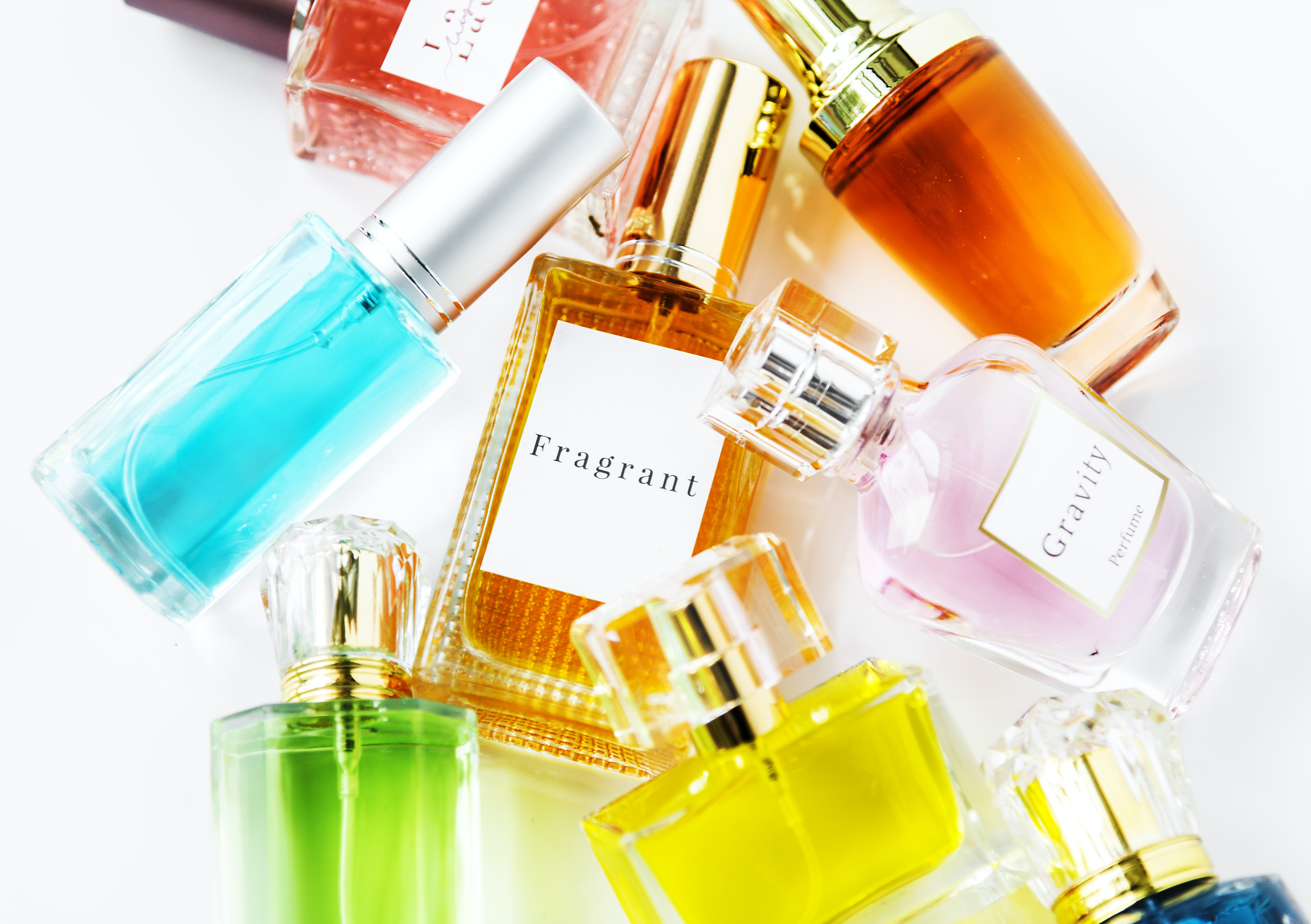 flat-lay photography of fragrance bottles