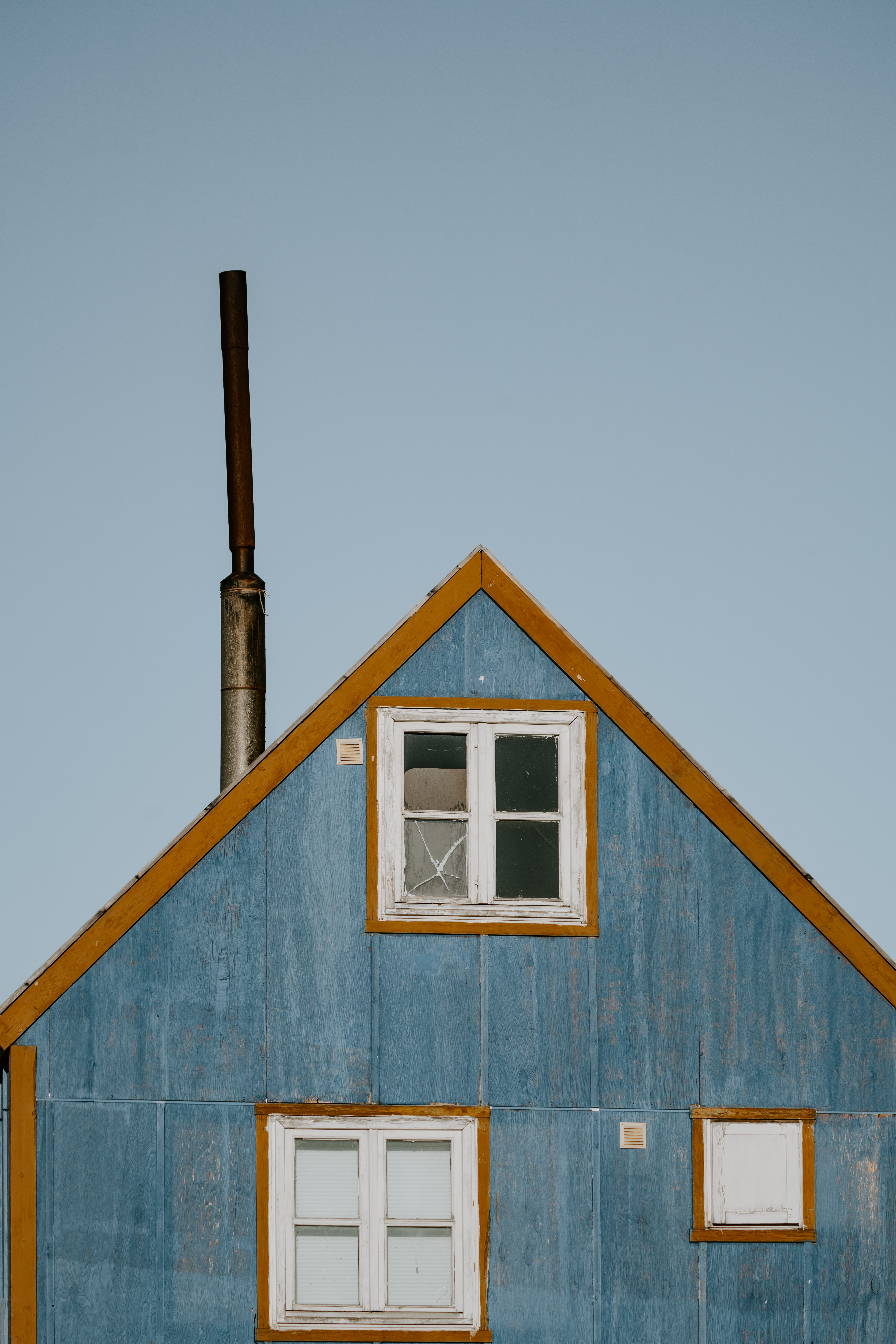 photo of blue and brown wooden house
