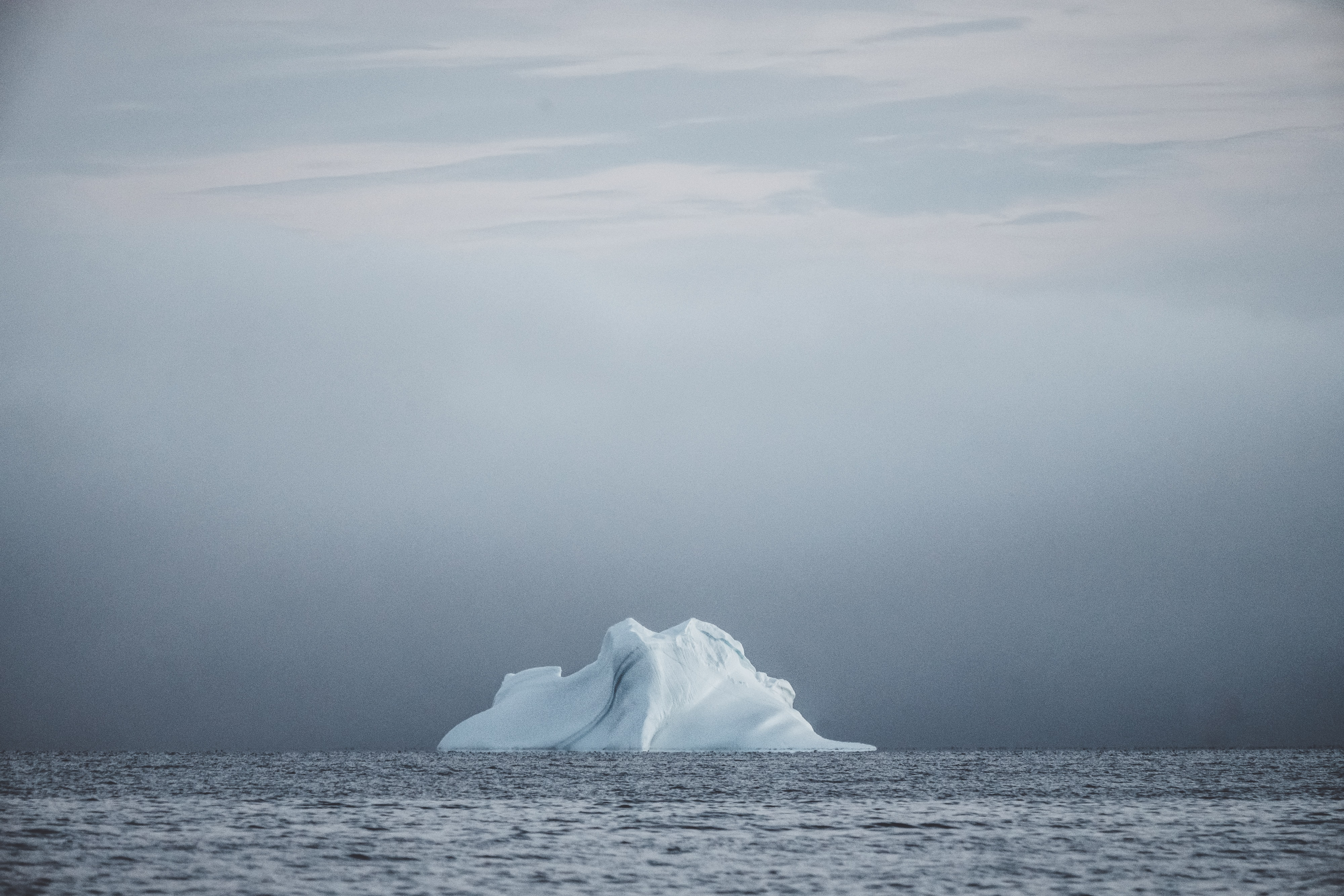 iceberg on body of water