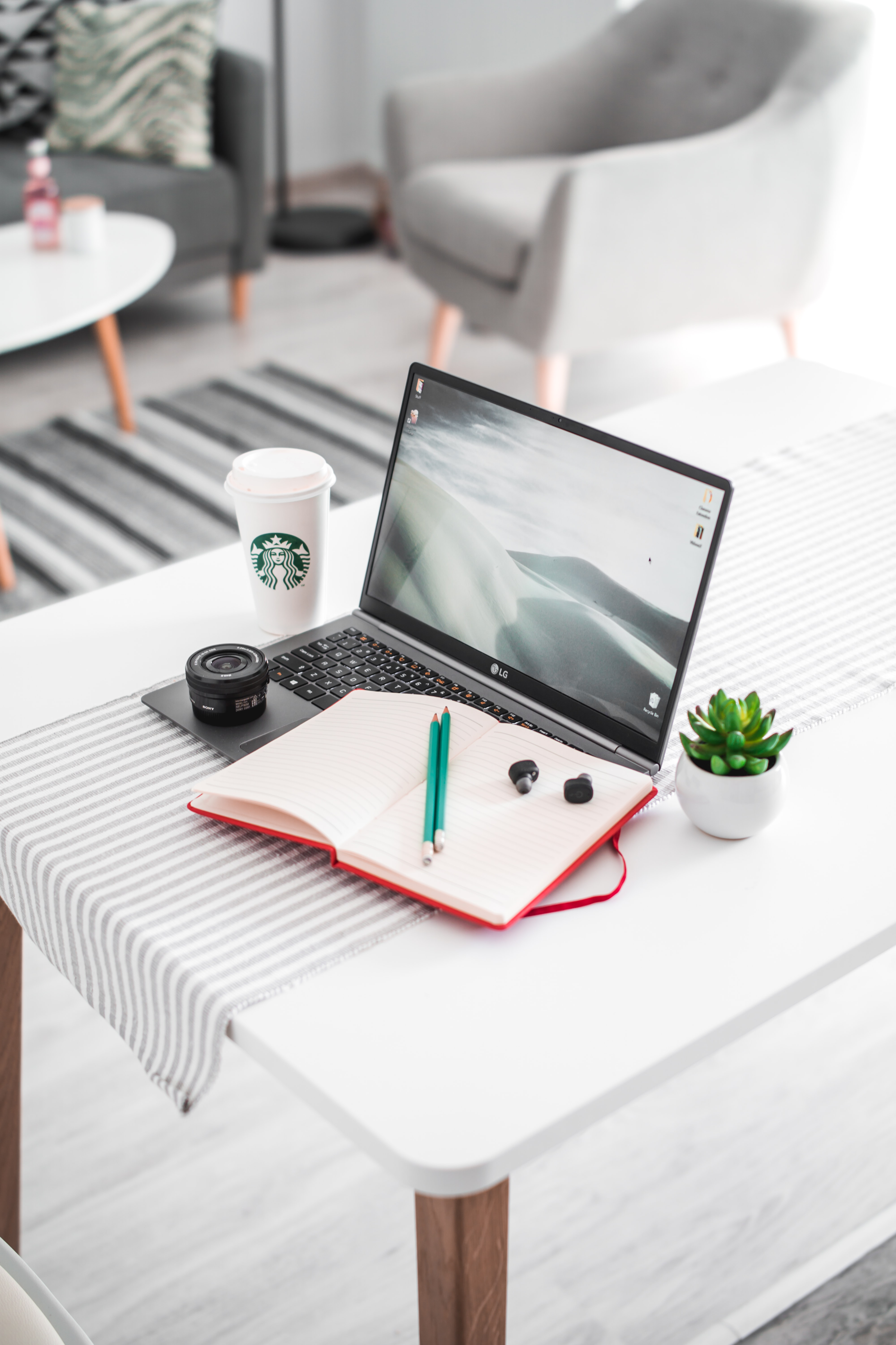 turned-on silver LG laptop on whit table