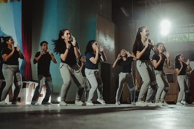 women's black shirt lot dance zoom background
