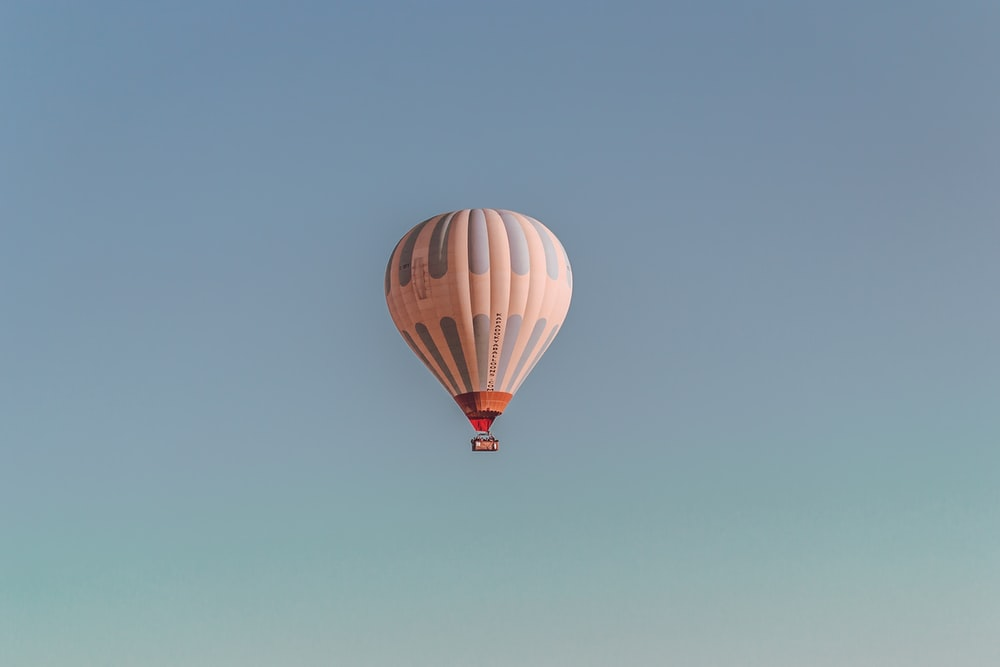 white and blue hot air balloon on sky