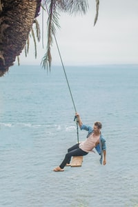 """I traveled out to a remote spot on the island only to find this amazing swing in paradise. We were on vacation so decided to take some risks. Let\u2019s swing into the water!\r\n\r\nIf you use this photo on your site, I would be very appreciative if you would please credit in the caption or meta to \""www.distel.co\""."""