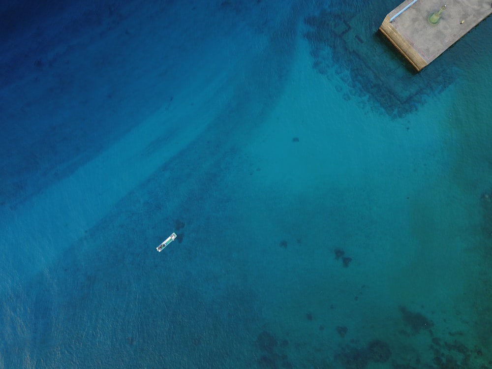 aerial photography of boat on sea at daytime
