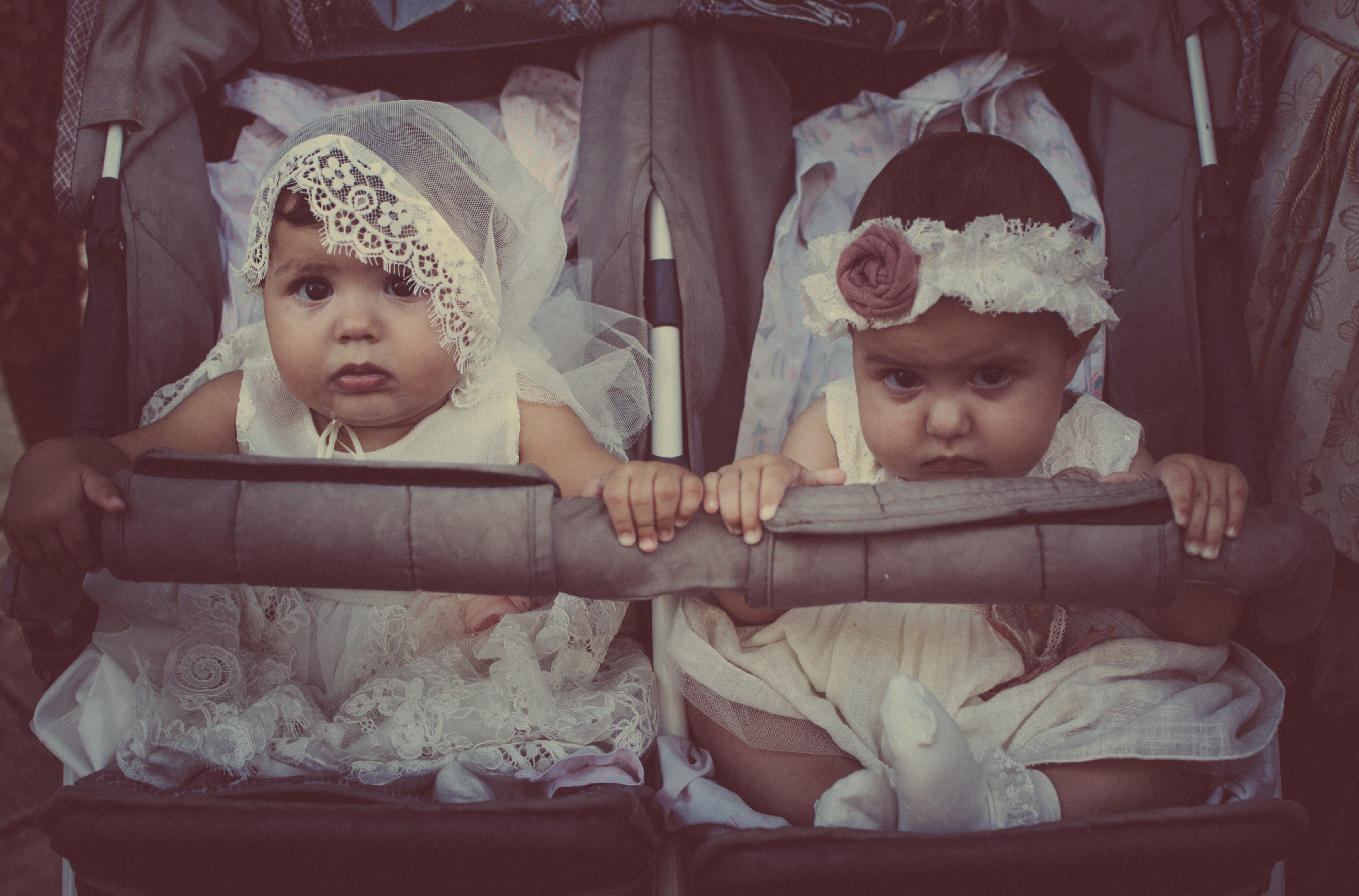 two girls on twin stroller
