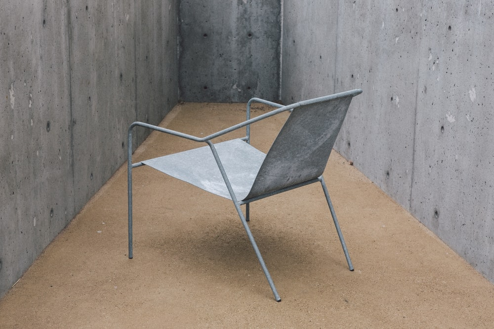 gray metal armchair inside room