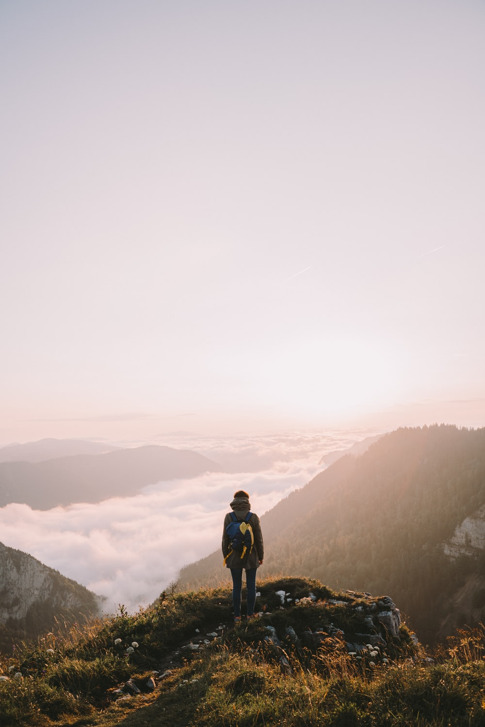 person on top of mountain