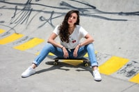 woman sitting on skateboard