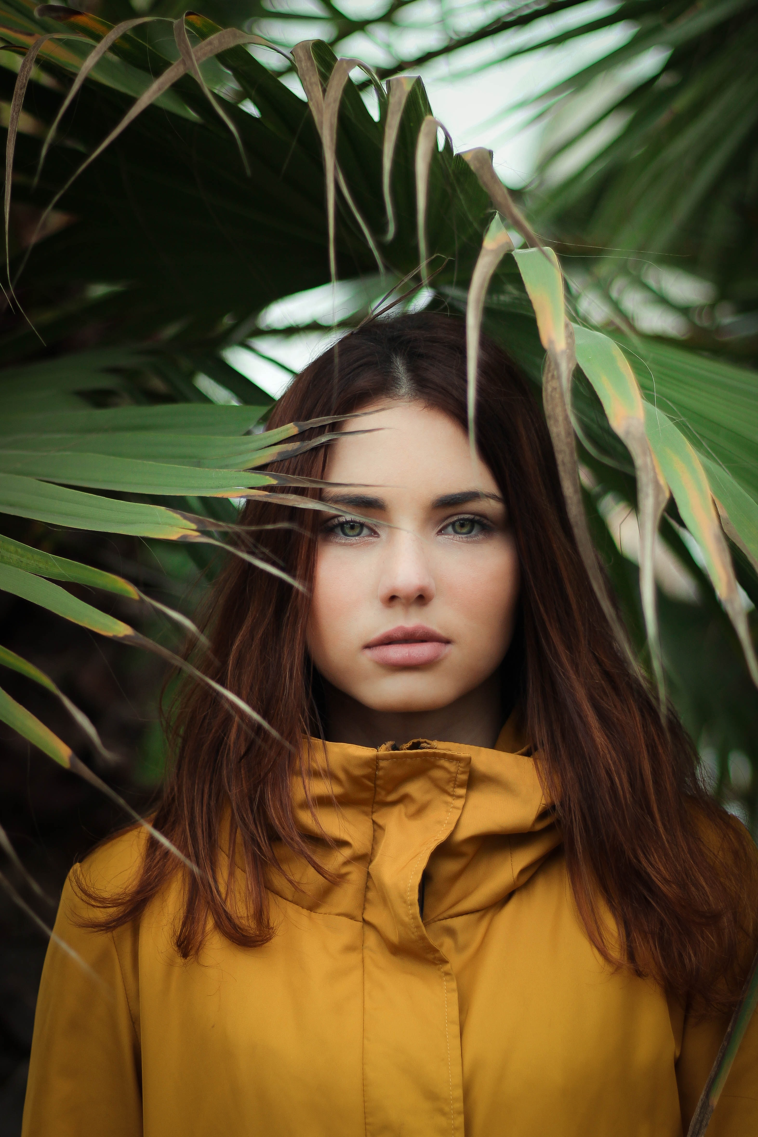 selective focus photography of woman wearing yellow jacket