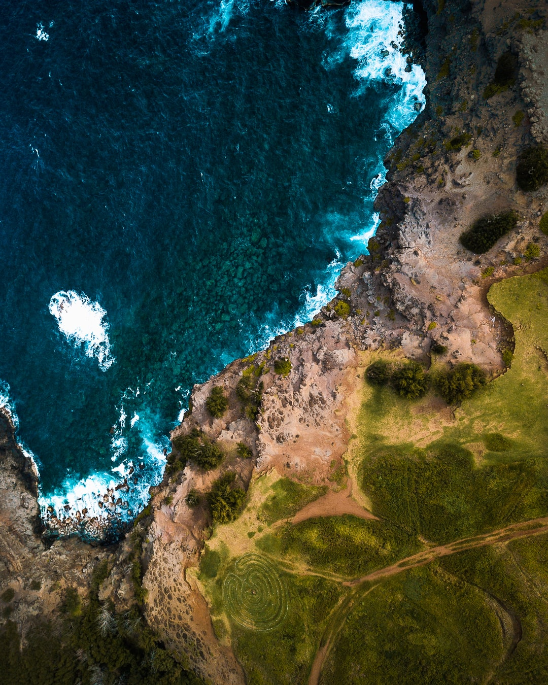 This shot is taken from the start of the Acid War Zone Trail. I was very tentative to put the drone up in the air here due to the strong winds but I'm glad I managed to fly straight up in the air and get this shot without too much risk. The North West Coast of Maui is oftened overlooked in favour of more popular destinations.... but these coastlines were very rugged and extremely fascinating to me. I'd highly recommend the trip.