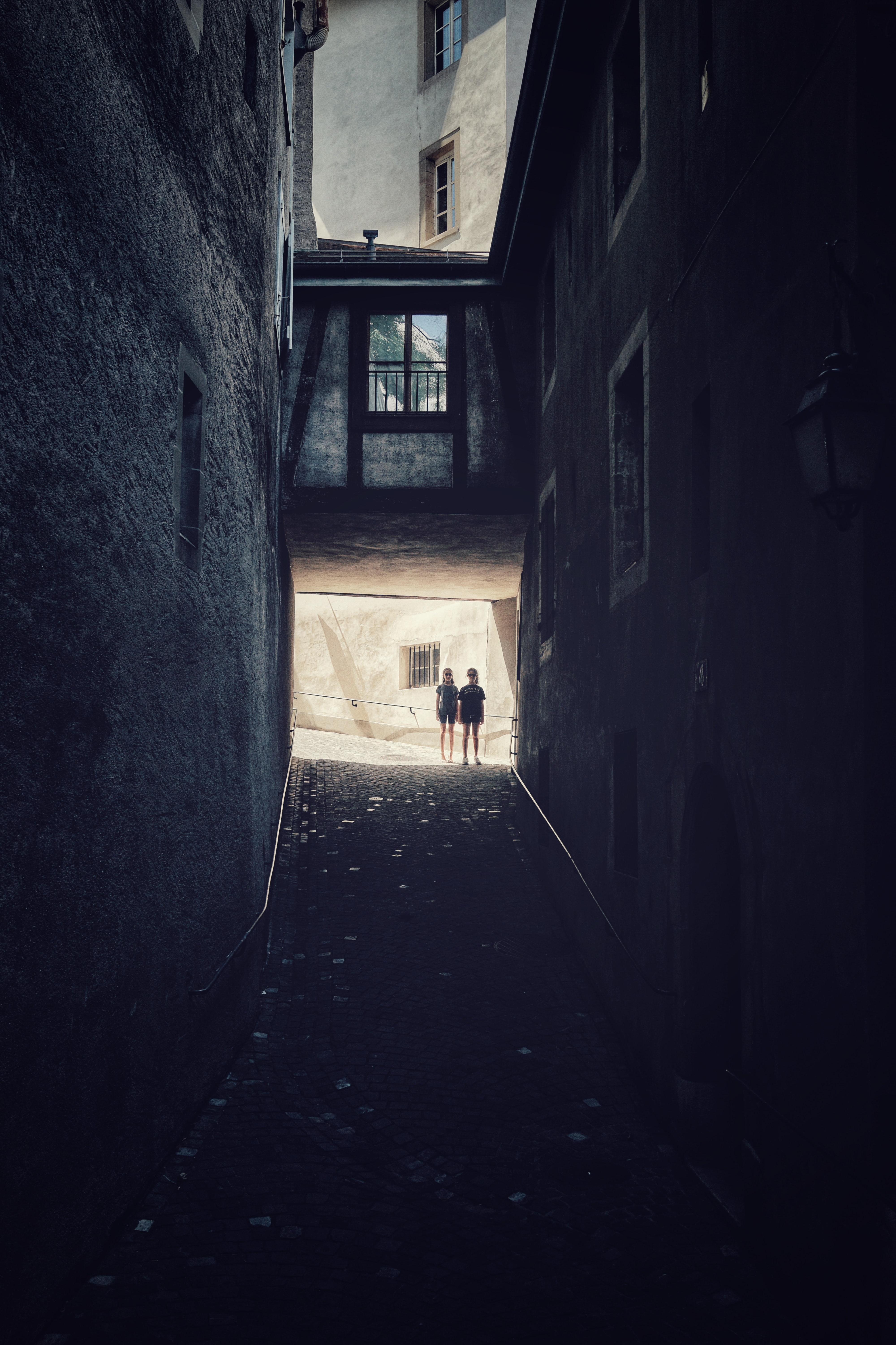 two person standing near wall