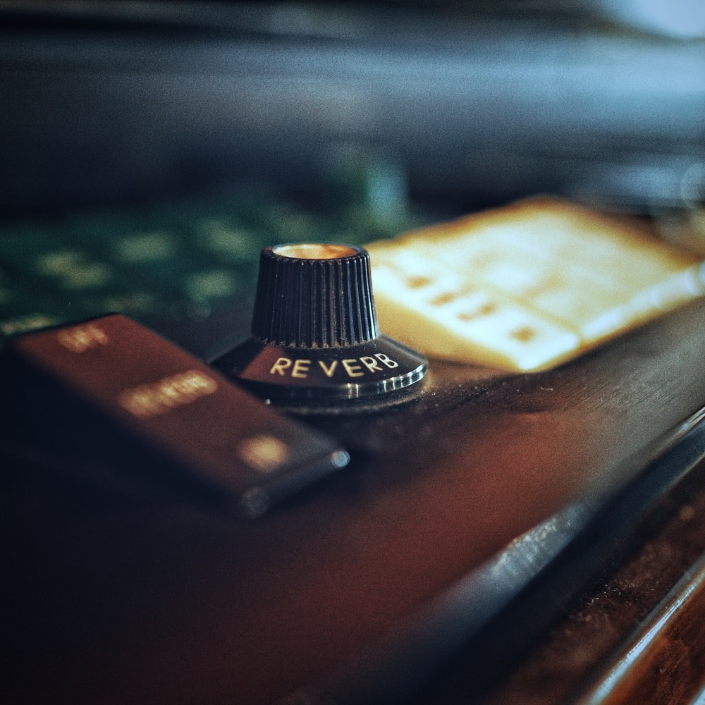 selective focus photography of reverb knob