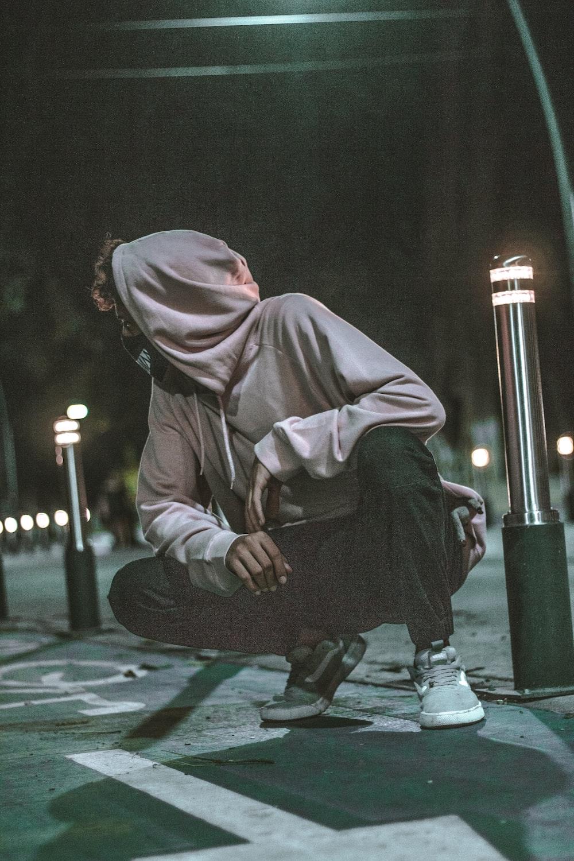 man sitting outdoor during nighttime