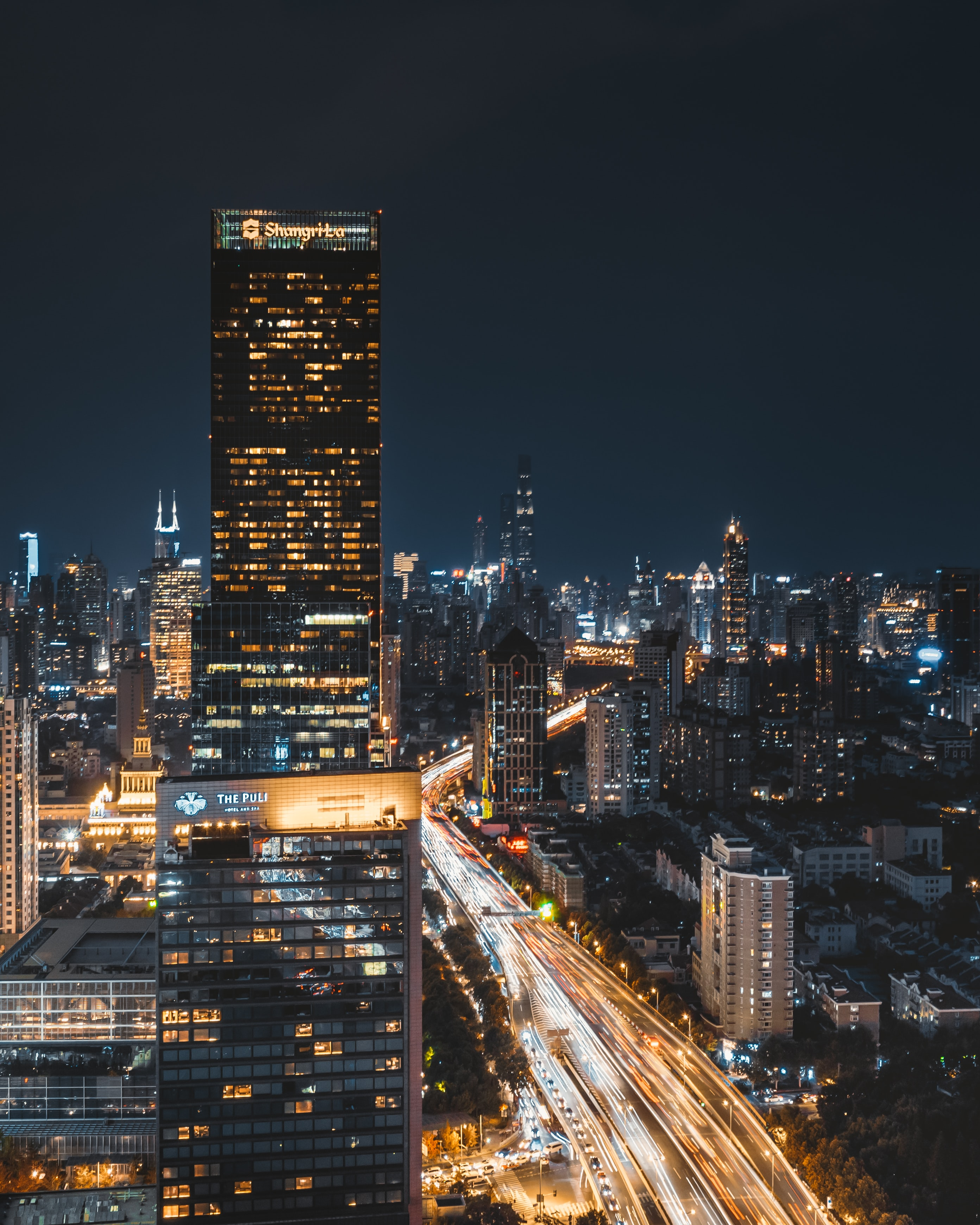 time lapse photography of high rise building