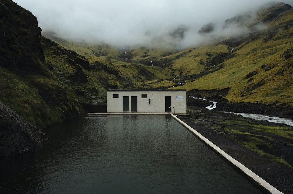 white cabin on mountain