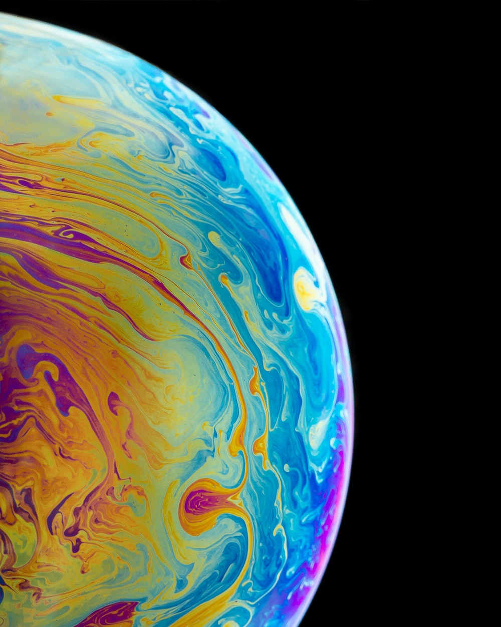 multicolored planet closeup photography