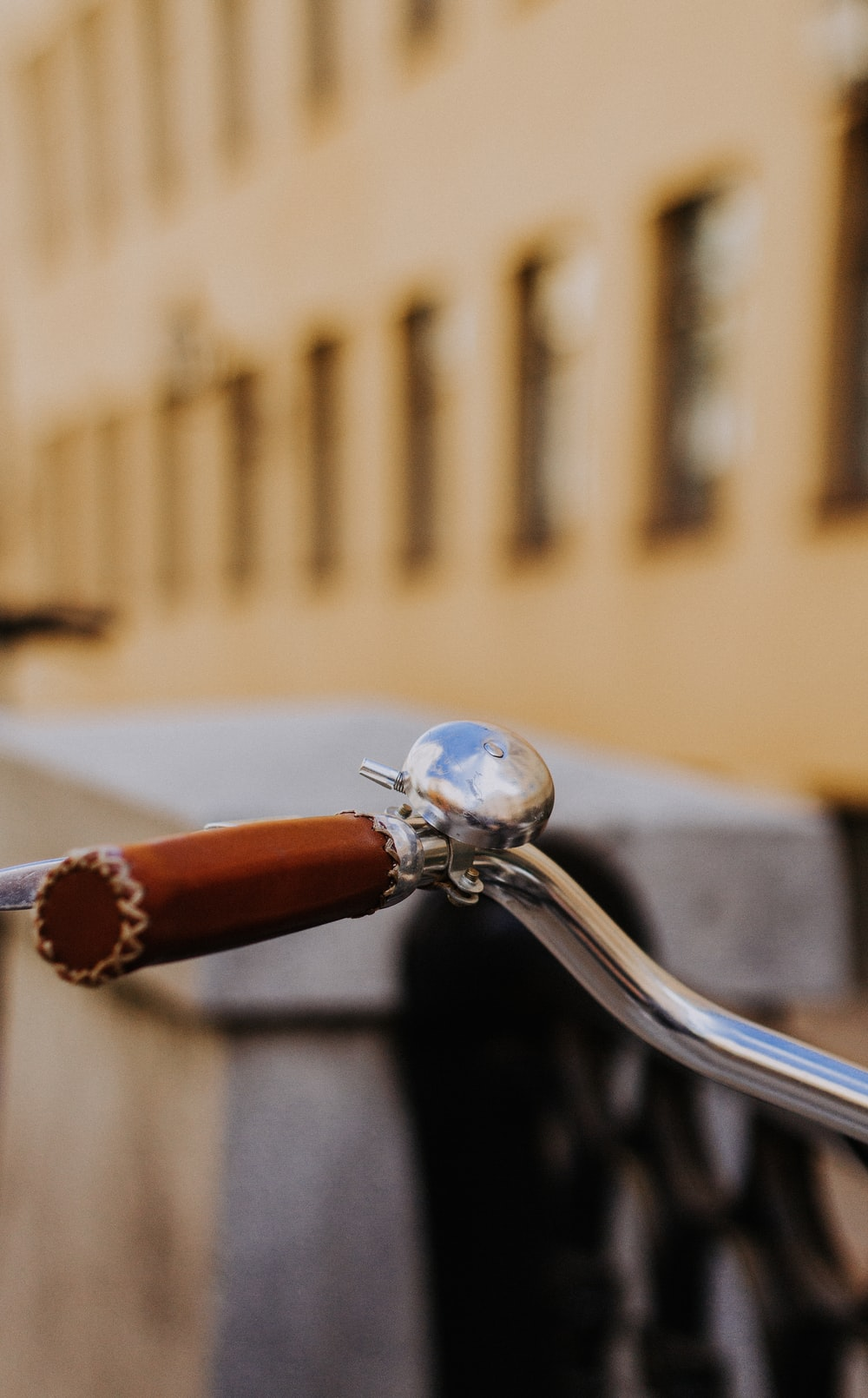 shallow focus photography of bicycle bell