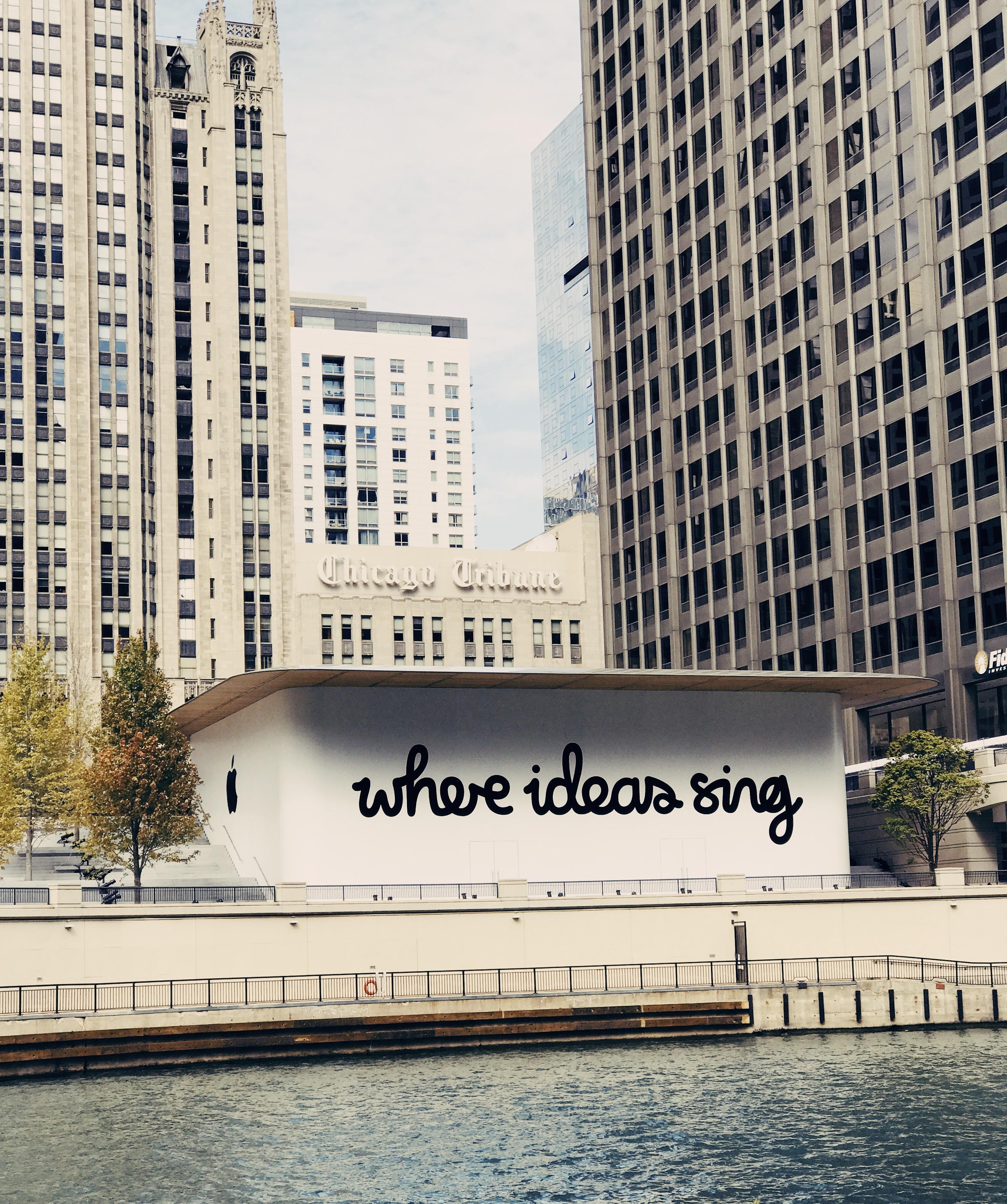 white concrete building near body of water