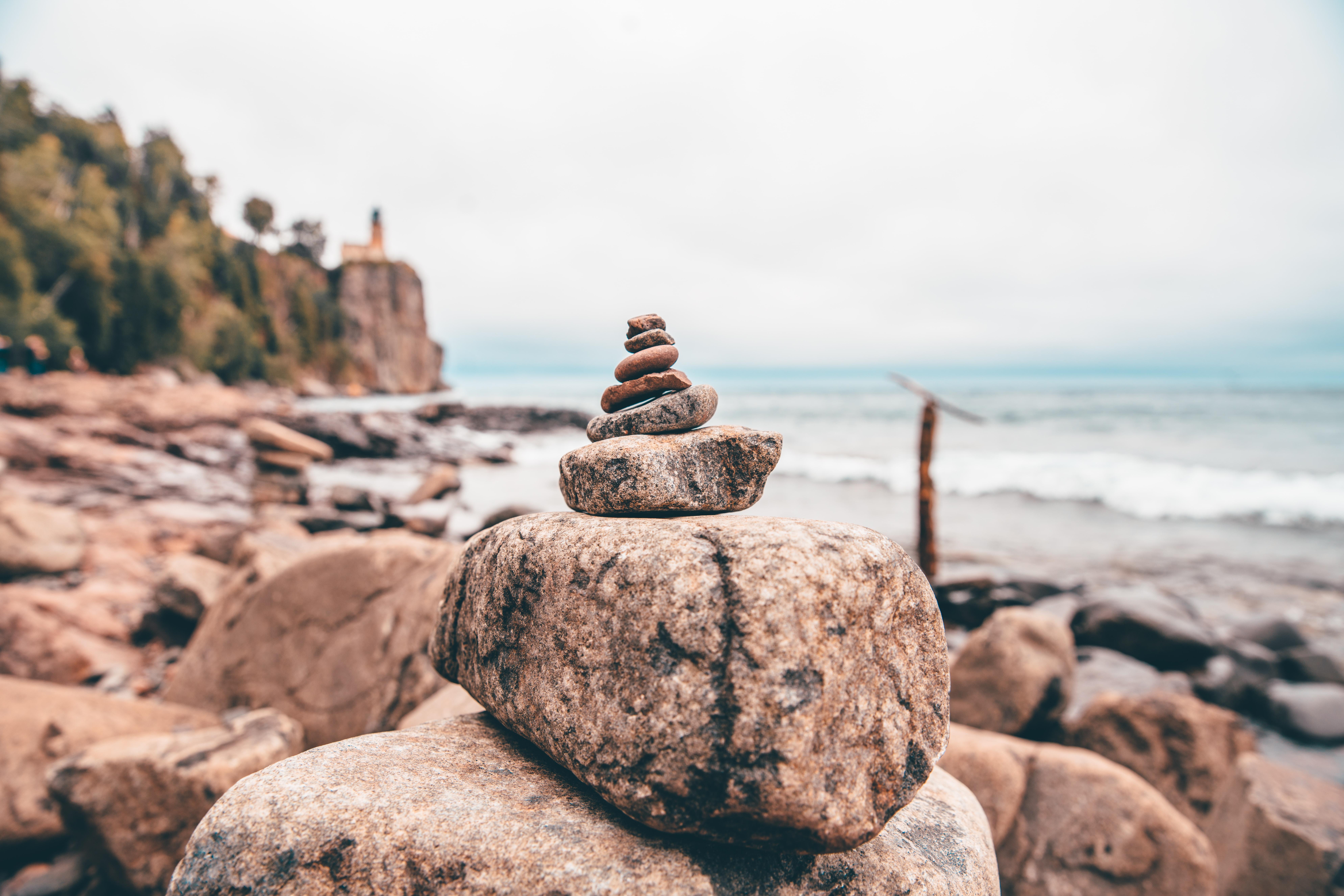 selective focus photography of stone balance