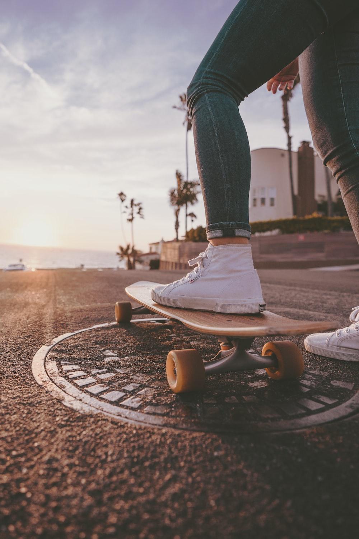 woman riding skateboard during daytime