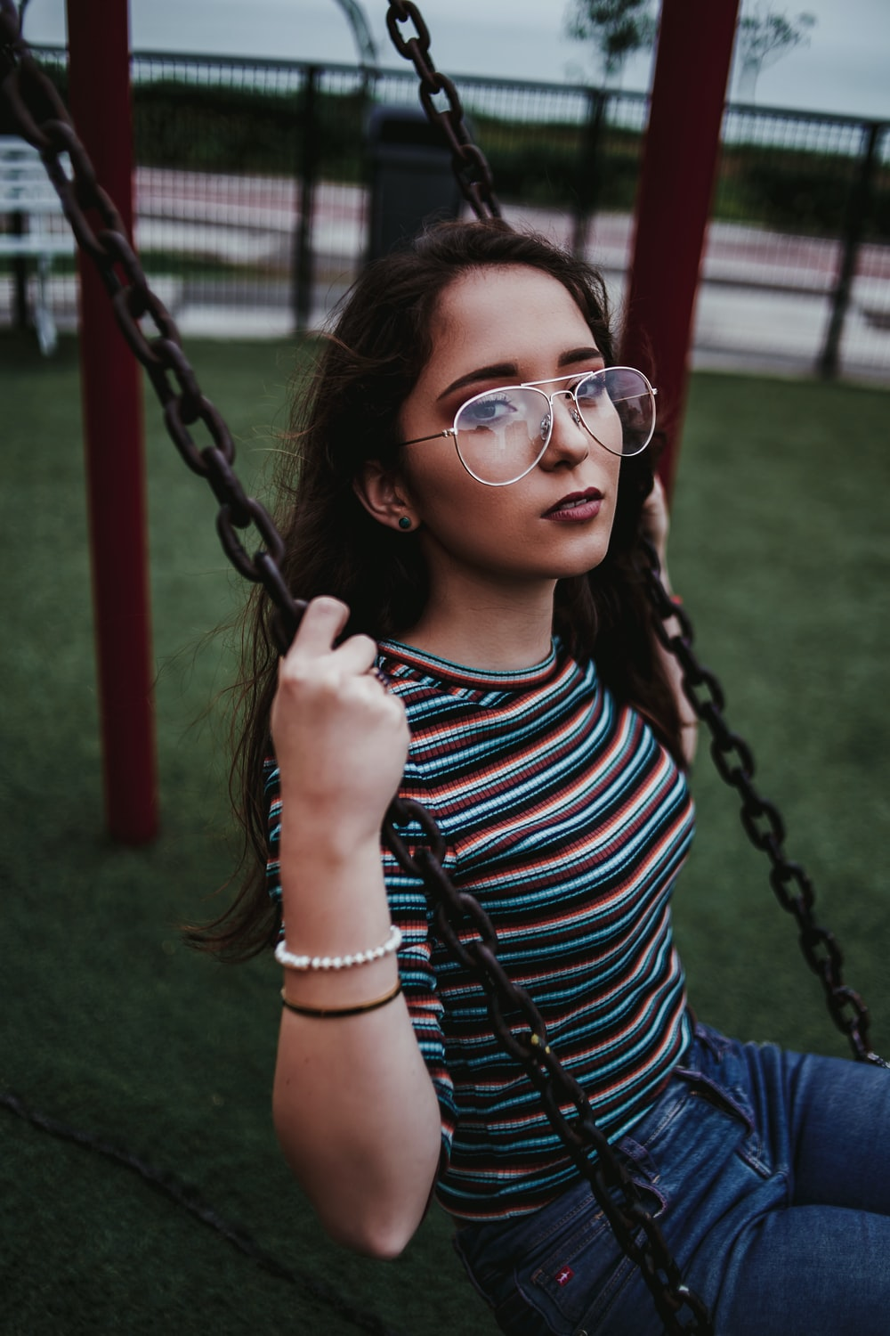 woman sits on swing