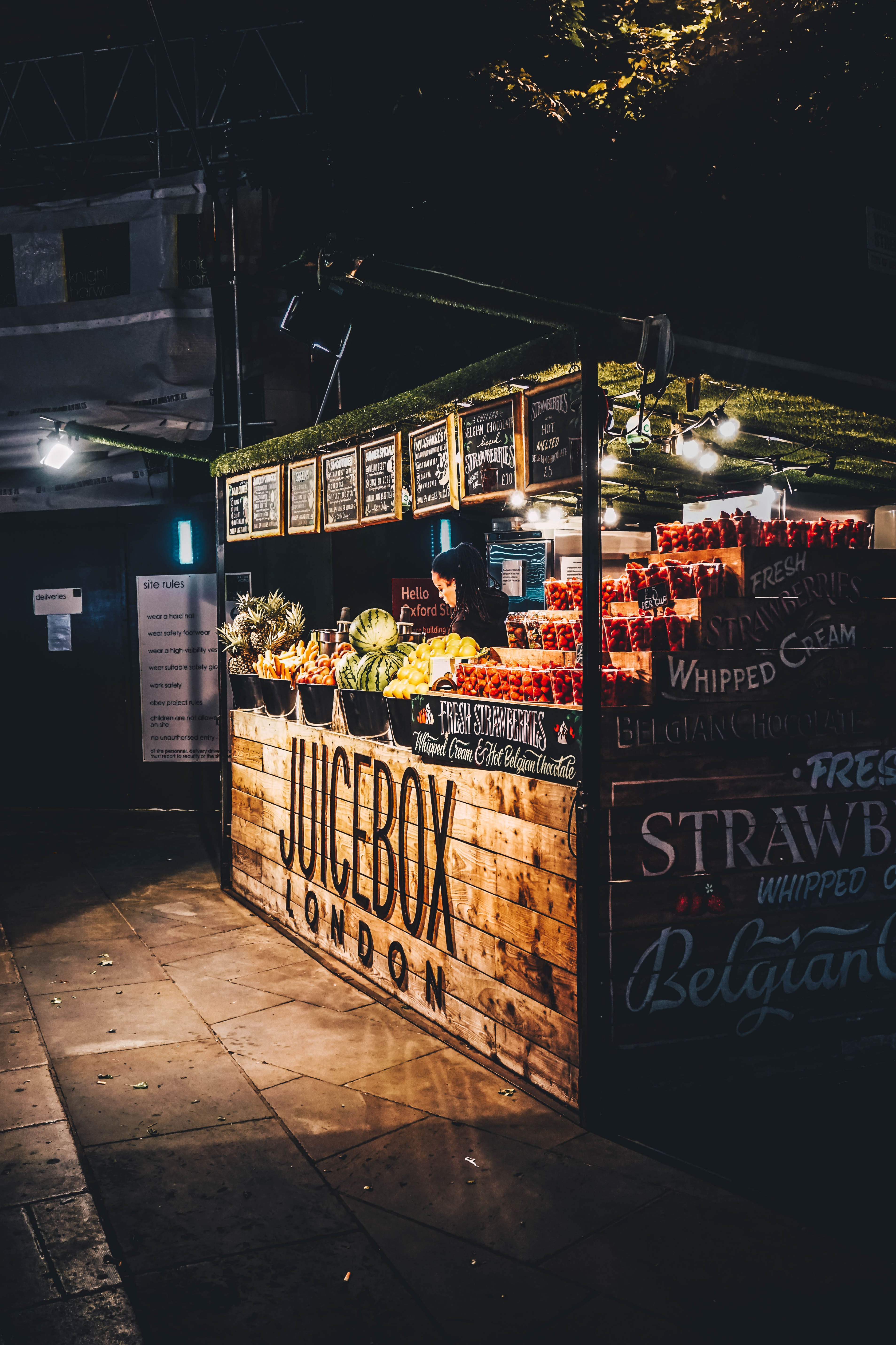 brown wooden fruit stand during nighttime