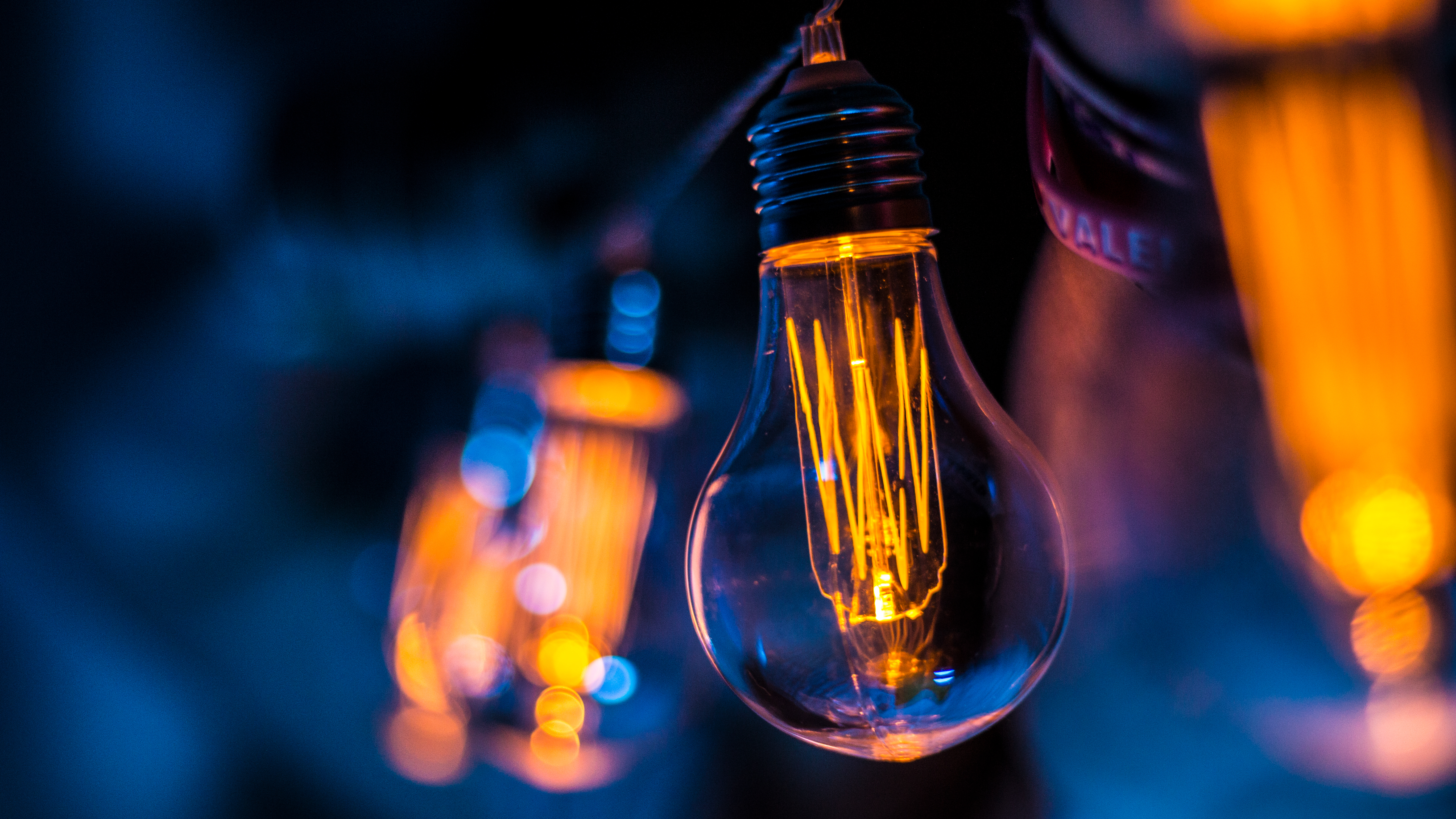 selective focus photography of clear light bulb
