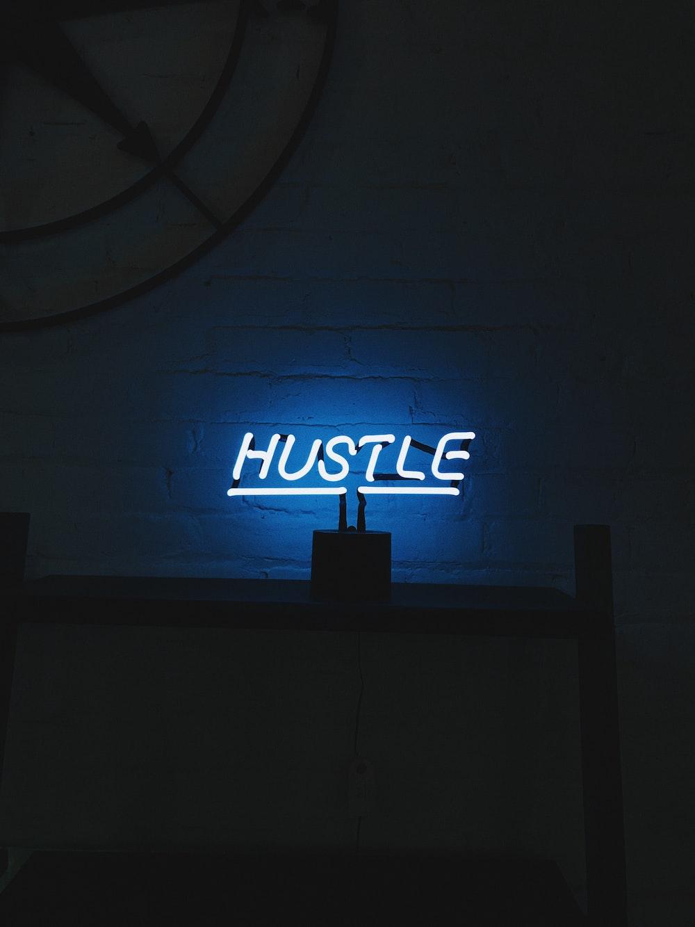hustle LED signage turned on
