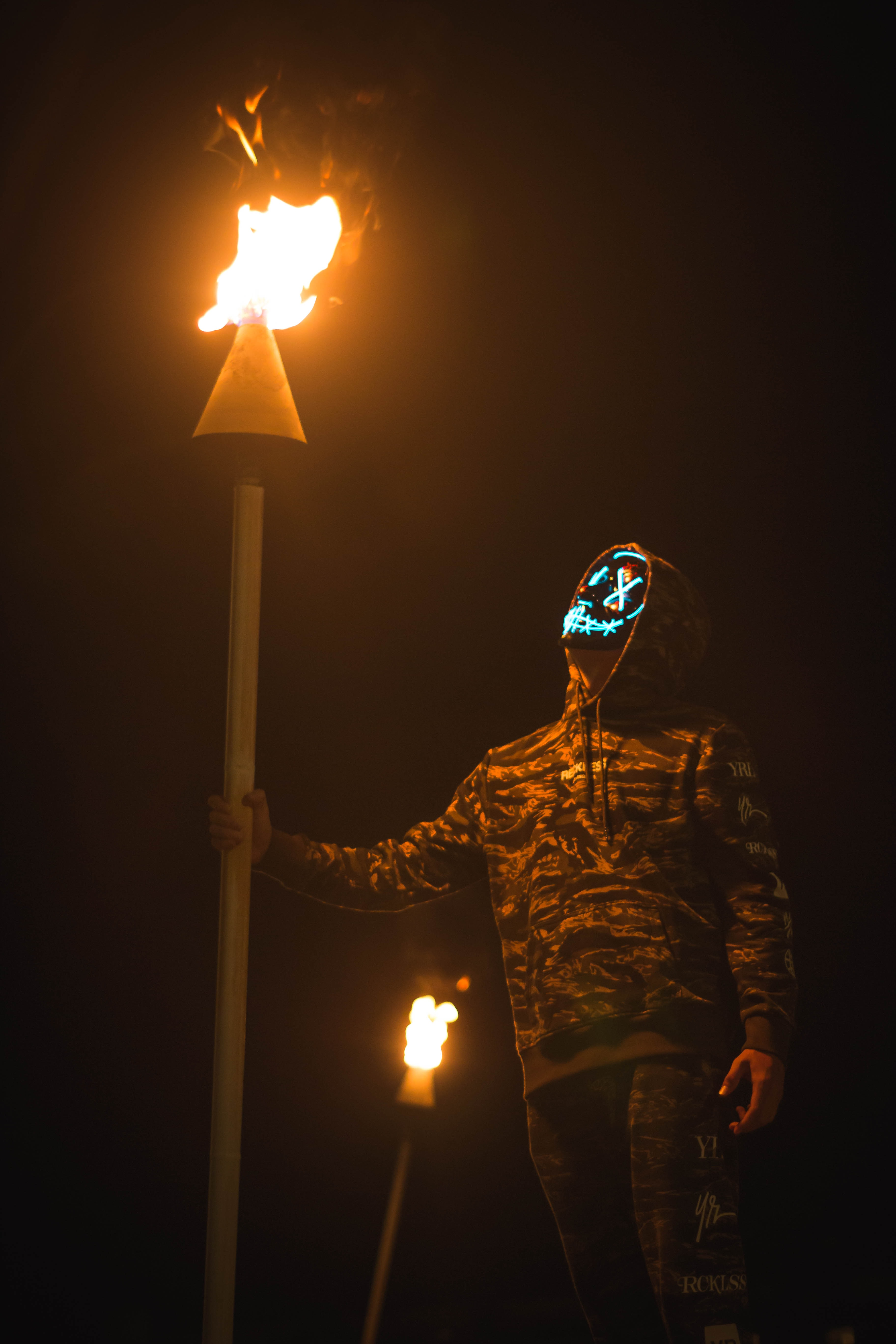 person holding torch while walking at night