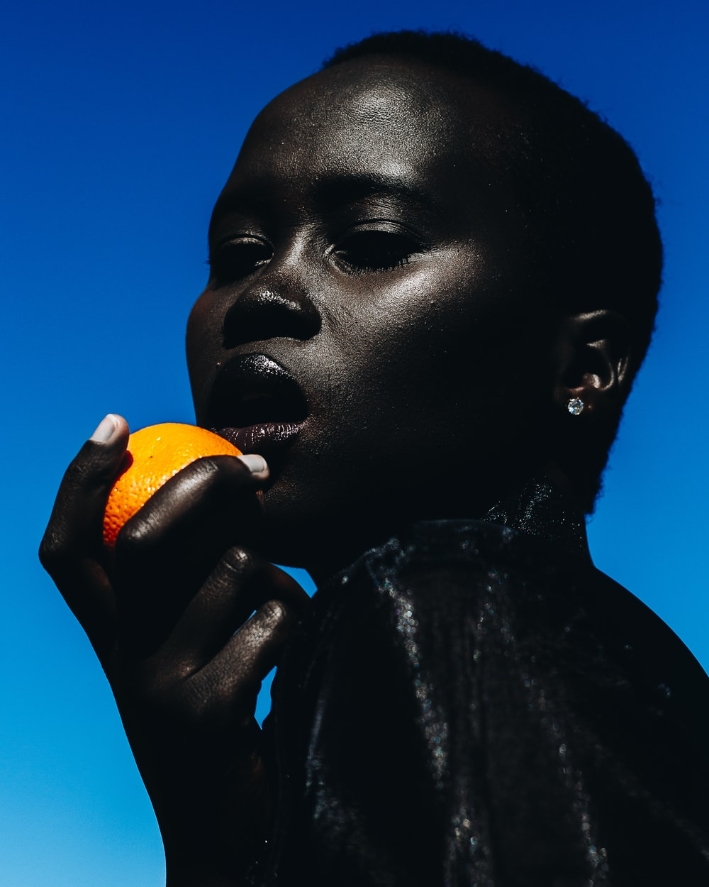 woman holding citrus fruit