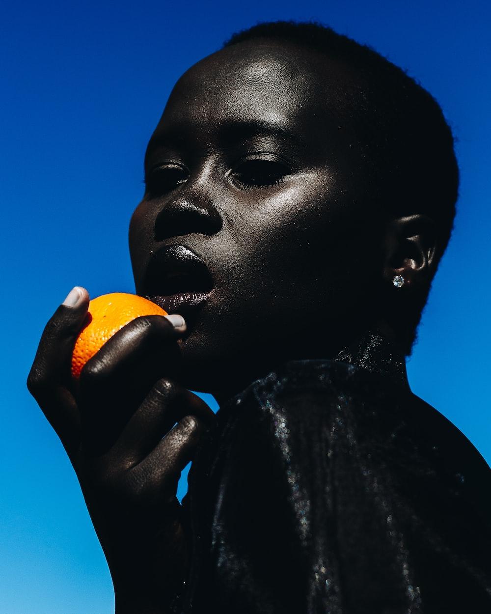 woman holding citrus fruit