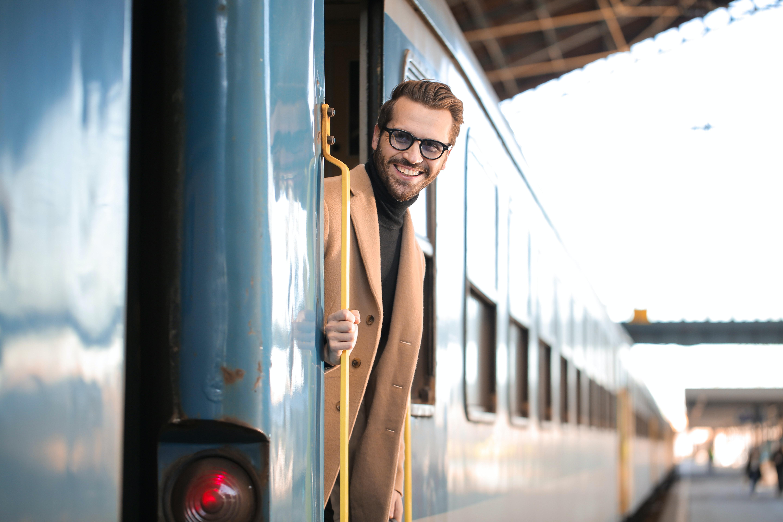 man riding train