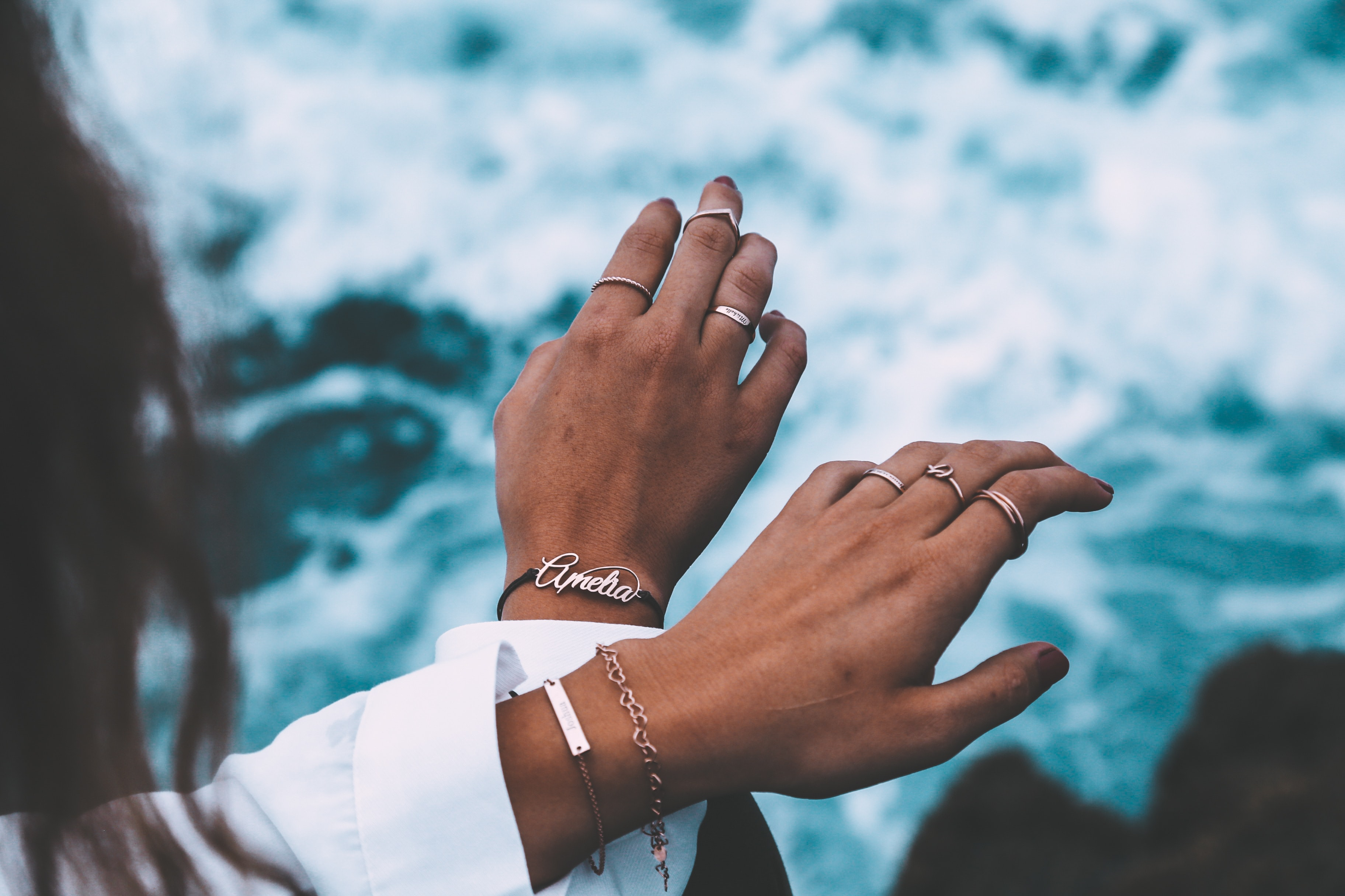 person wearing silver-colored rings