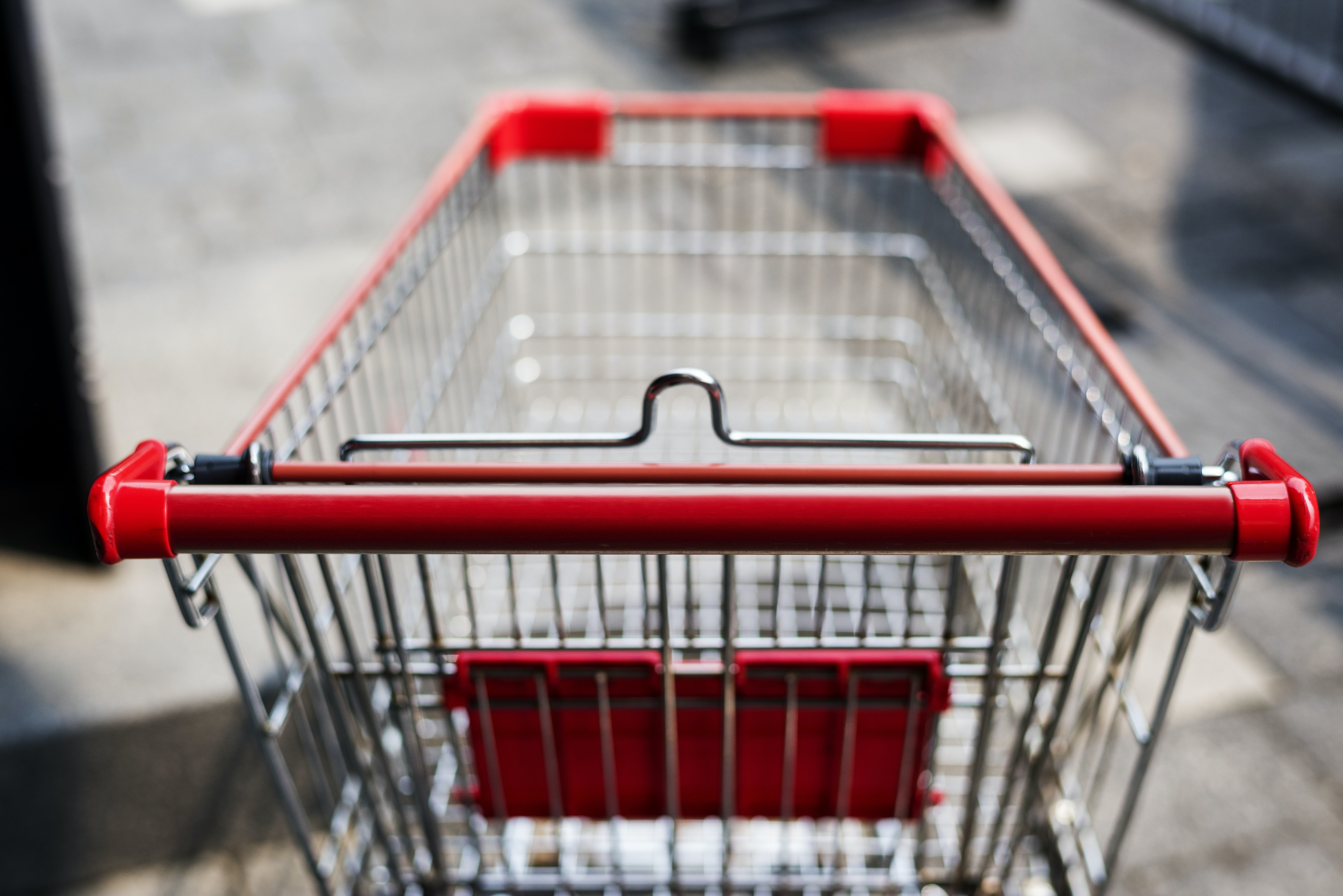 shallow focus photography of gray and red grocery cart